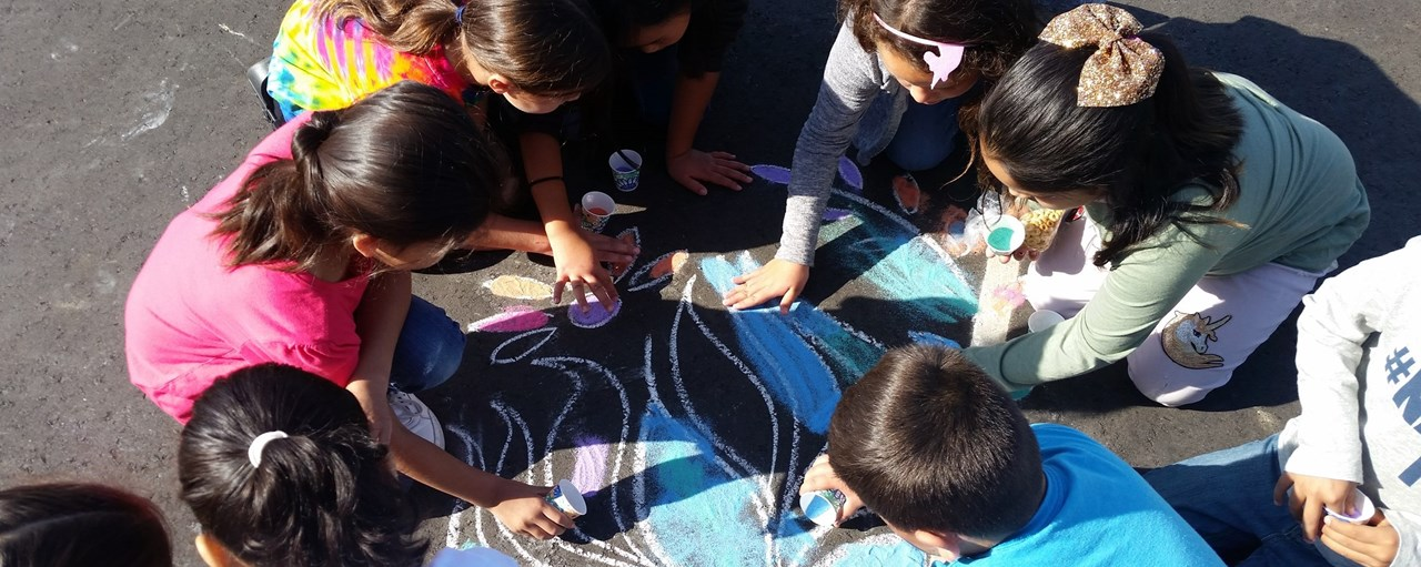 Students Doing Rangoli Sand Art on Blacktop